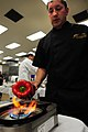 US Navy 100427-N-3659B-193 Senior Chief Culinary Specialist Eric Amador roasts a red bell pepper while preparing a dish for the 2010 Navy Region Southwest Culinary Competition.jpg
