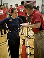 US Navy 100512-N-6932B-136 Brian Ficker, an official judge from the National Archery Association advises Culinary Specialist Judith Boyce during the archery competition at the inaugural Warrior Games.jpg