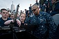 US Navy 100614-N-5319A-071 Chief Fire Controlman Job Schuck instructs Yeoman 3rd Class Diana Grams and other Sailors on the operations of a firing .50-caliber machine gun.jpg