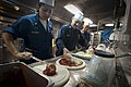 US Navy 100626-N-5319A-017 Chief Fire Controlman Guadalupe Galindo and Chief Hull Technician David Moser make pizza.jpg