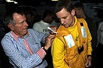 US Navy 100714-N-4938S-035 Former President George H.W. Bush autographs Lt. Carl White's flight deck life preserver vest during a visit to the aircraft carrier that bears his name, USS George H.W. Bush (CVN 77).jpg