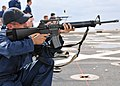 US Navy 101109-N-8113T-146 Quartermaster 3rd Class Michael Reilly shoots an M-16 rifle during a weapons qualification course aboard the amphibious.jpg