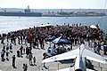 US Navy 110911-N-OB313-008 Visitors to the USS Midway Museum pay tribute to the victims of the Sept. 11, 2001 terrorist attacks.jpg