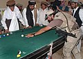 US special forces playing pool at a village in Afghanistan.jpg