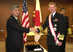 Dennis C. Blair - US Navy Admiral Dennis C. Blair being presented the badge and ribbon of Order of the Rising Sun. (2005)