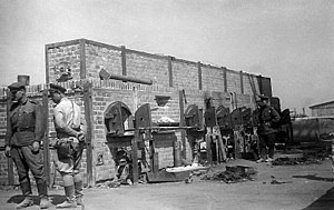 Majdanek concentration camp - Red Army soldiers examining the ovens at Majdanek, following the camp's liberation, summer 1944