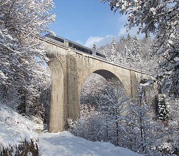 Train on the Saillard bridge after snowfall