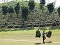View of Zareen Tea Estate with Man Bearing Load - Near Srimangal - Sylhet Division - Bangladesh (12950098074).jpg