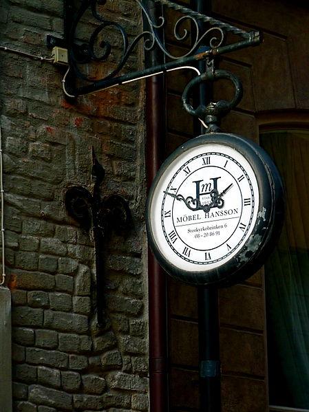 File:Vintage looking Clock Sign of Möbel Hansson in the Old Town in Stockholm Sweden (6116259031).jpg