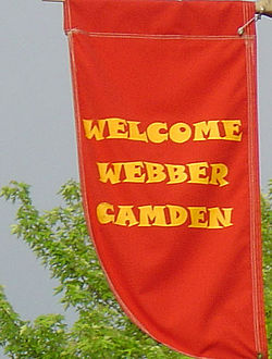 Banners hanging from streetlights welcome visitors to the Webber-Camden neighborhood