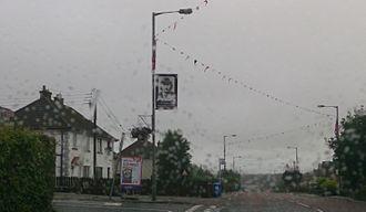 Moygashel - A banner commemorating Wesley Somerville on Moygashel's Main Street, 2013