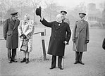 Winston Churchill raises his hat in salute during an inspection of the 1st American Squadron of the Home Guard at Horse Guards Parade in London, 9 January 1941. H6550.jpg
