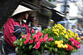 Woman selling flowers for lunar holiday (3695183590).jpg