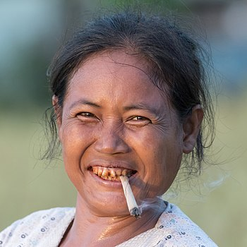 Woman with hand-rolled cigarette