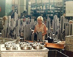 Industry - A female industrial worker amidst heavy steel semi-products (KINEX BEARINGS, Bytča, Slovakia, c. 1995–2000)