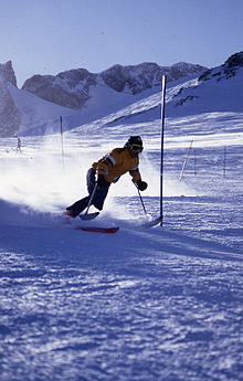 man skiing down hill