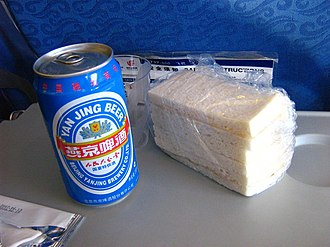 Beijing Yanjing Brewery - A can of Yanjing Beer served on board an Air China plane