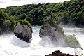 You can the visitors standing on the rockisle in the middle of the Schaffhausen waterfall - panoramio.jpg
