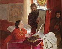 A boy is sitting at a table and is looking at a large open book held by a bearded standing man. The table is covered with books and papers. A woman is sitting by the wall and looking at the man