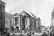 Prager Ständetheater von Vinz. Morstadt, ehemals Nationaltheater des Grafen Nostitz. Links: Carolinum, rechts: im Hintergrund Obstmark. Um 1830. Lav. Sepiazeichnung. (Quelle: Wikimedia)