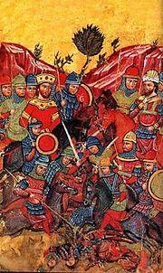 Ο Μ. Αλέξανδρος , που παριστάνεται ως Αυτοκράτορας του Βυζαντίου, κατατροπώνει τον Δαρείο και την ακολουθία του. Παράσταση από την μυθιστορία του Αλέξανδρου (κώδικας του Ελληνικού Ινστιτούτου της Βενετίας)