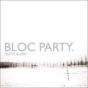 "Mostly white album cover with winter image of grey tree line in distance, captioned ""BLOC PARTY."" and (much smaller) ""SILENT ALARM"" below it."