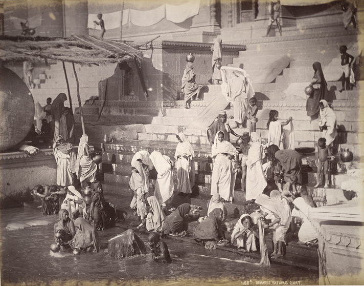 Women and children at a bathing ghat on the Ganges in Banares (Varanasi), 1885.