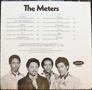 Album's back cover depicting band members in 1969. Left to right: Modeliste, Neville, Porter, Nocentelli.