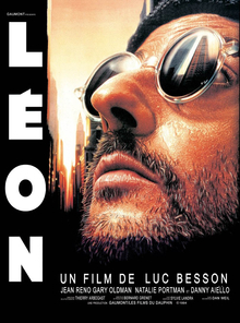 Picture of Jean Reno as Leon: He is bearded and wearing sunglasses looking upwards.