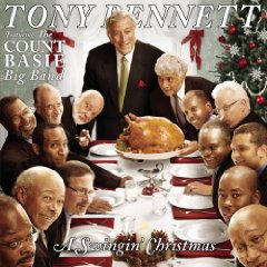 Tony Bennett standing at the head of the table during a holiday meal gathering of over a dozen men as the turkey arrives.