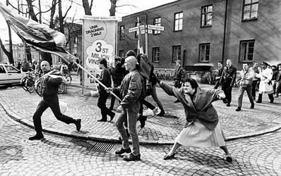 A Woman Hitting a Neo-Nazi With Her Handbag.jpg