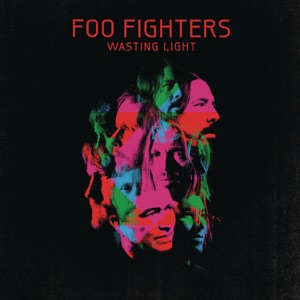 "A collage of green, blue and pink face pictures of the Foo Fighters members against a black background. Above it is the title ""FOO FIGHTERS - WASTING LIGHT"" in red letters."