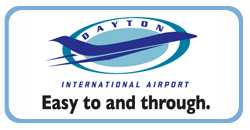 "Logo for Dayton International Airport containing airport name, aircraft silhouette, and the slogan ""Easy to and through."""
