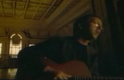 A shot of Clapton in the video. Change the World Music Video.png