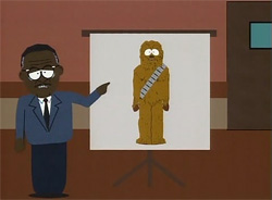 In this scene from the television series South Park, Johnnie Cochran stands in a courtroom next to a large screen on a tripod. He points to a picture on the screen of Chewbacca, who is wide-eyed and standing stiffly.