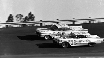Lee Petty No. 42 and Johnny Beauchamp No. 73 battle on the last lap of the 1959 Daytona 500.