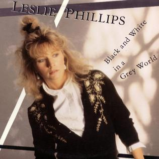 <i>Black and White in a Grey World</i> 1985 studio album by Leslie Phillips