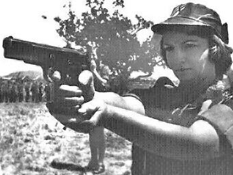 Rhodesian servicewoman takes aim with her Browning Hi-Power 9x19mm semi-automatic pistol; from a 1976 army recruitment poster Rhodesian Army recruitment Bush War 1976.png