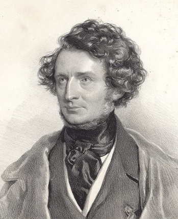 head and shoulders of middle-aged white man, with dark bushy hair; clean-shaven except for neat side-whiskers