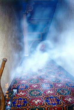 Hazy white smoke in a hallway showing alleged ghost sighting