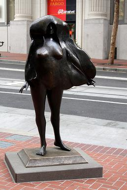A nude bronze statue of a woman