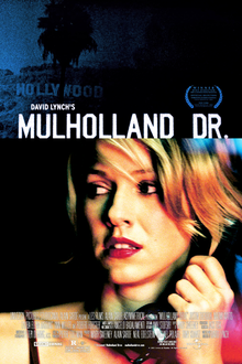 Theatrical release poster showing the film's title against a dark blue image of the Hollywood Sign in Los Angeles atop another still shot of Laura Elena Harring in a blonde wig staring at something off camera toward the lower right corner