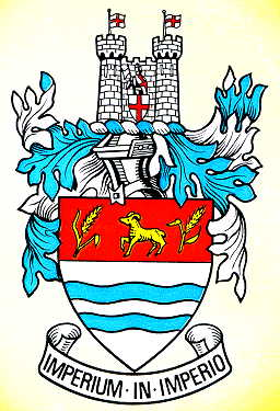 "The coat of arms of the former Wetherby Rural District Council, the first such arms to be granted by the College of Arms to a rural district council, on 7 January 1938. The motto translates as ""One government within another."" Wetherbycoatofarms.jpg"