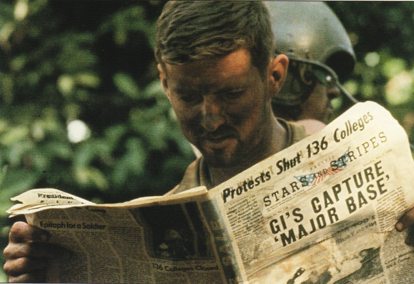 News From Two Fronts American Soldier Reading Stars And Stripes The Official US Armed Forces Newspaper While In Cambodia