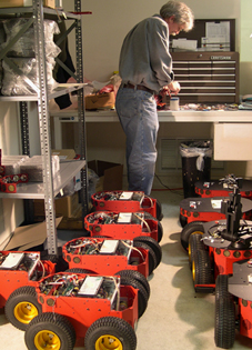 A robot technician builds small all-terrain robots. (Courtesy: MobileRobots,  Inc.)