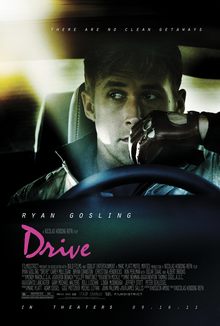 A blonde-haired man sits behind the wheel. He wears a fleece jacket and a pair of brown driving gloves. Above reads a tagline,