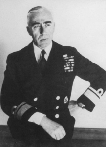 Seated middle-aged man in naval uniform, looking right