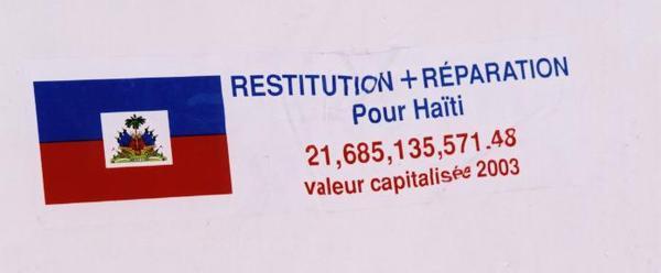 Sticker_demanding_reparations_for_Haiti,