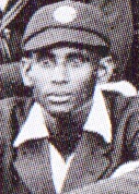 A headshot of a cricketer wearing a cap