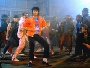 "Jackson during a dance step in the music video for ""Beat It"". Michael Jackson - Beat It music video.jpg"